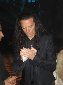Providing his autograph to a fan