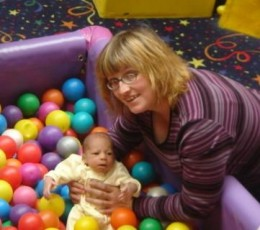Thank God Mommy is holding me; I'd get lost in all these balls!