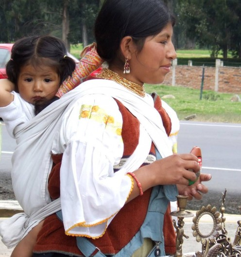 This Ecuadorean mother carries her baby in the traditional baby wrap, freeing her hands to work.