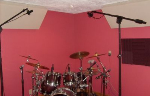 A Quality Room & Drum Kit: Live drums played by a pro are the backbone of a great sounding demo
