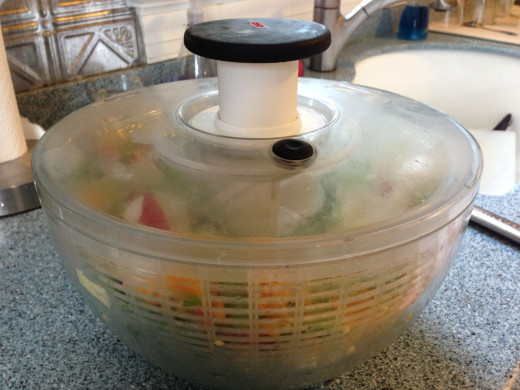 Here is the Oxo Salad Spinner ready to be spun. A few presses of that top black button and water is shed.