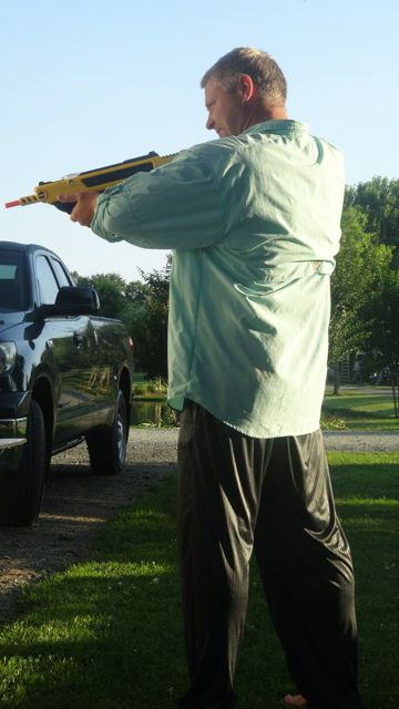 John posed for action against pesky flies. Last count: John 24, flies 3.