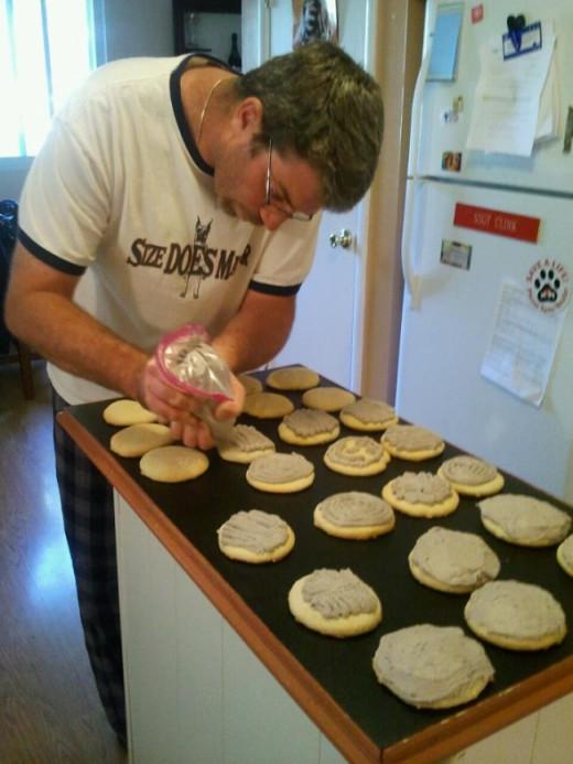 Eric decorates sugar cookies