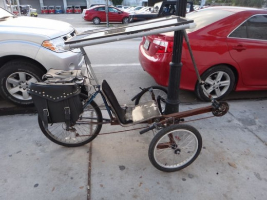 It's not a car but I thought this bike was very cool. It has solar panels!