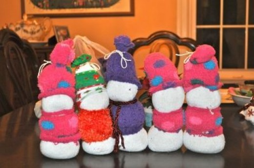 A family of sock snowmen ready for decorations.