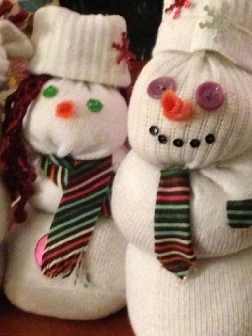 Look to me like these two sock snowmen (actually, one is a snow woman) are on a date