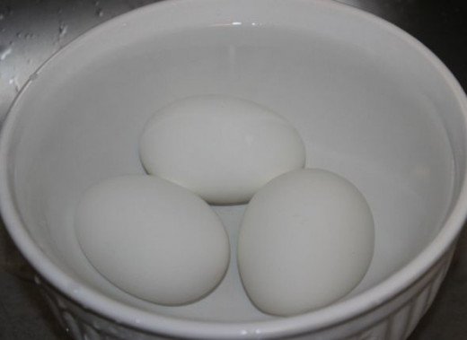 Boiled eggs, chilling in water