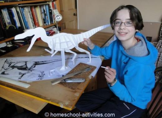 My daughter making her homeschool Velociraptor