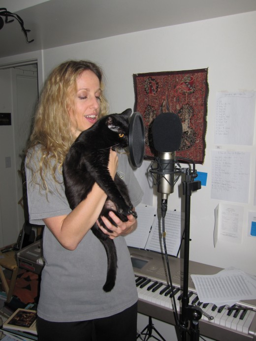 "Molly is a featured vocalist in Kristen's song, ""Cats In The Catacombs.""  Her hisses and growls show she did not like to be held up to the mikes."