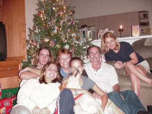 Our Fam in 2000 (notice homemade luminaries on counter)