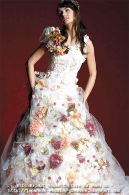 Couture Princess-line wedding gown with multi-colored fabric rosettes by Bibi Bridal House