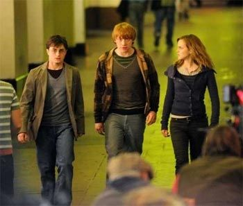 Daniel Radcliffe, Emma Watson and Rupert Grint filming scenes in central London for Harry Potter and the Deathly Hallows.