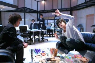 """""""Checkmate!"""" Light Yagami and L face off -- literally -- in a game of chess."""