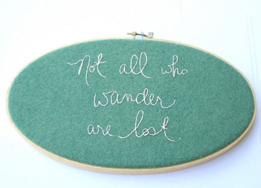 Not all who wander are lost - oval hoop with green wool felt.