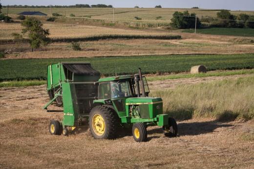 A John Deere Round Baler in the hay field