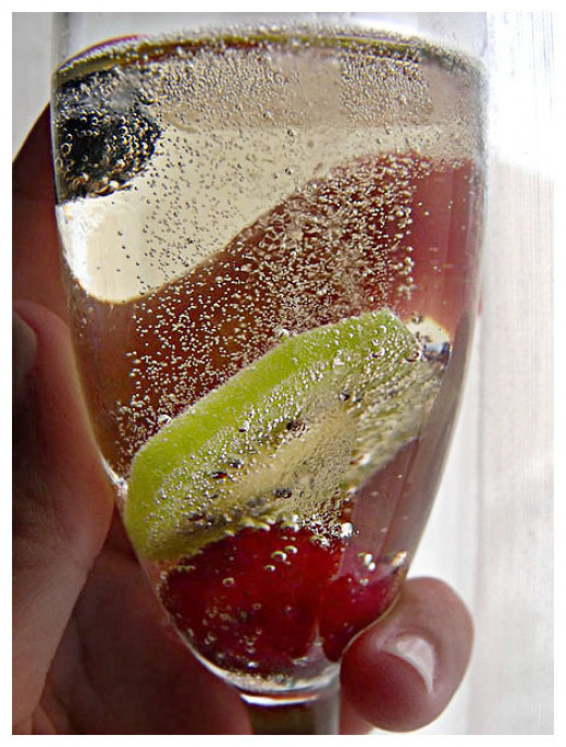 Champagne and fruit and a simple fluted glass documents the night of our wedding.