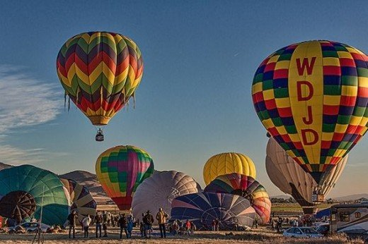 Ballons being inflated and rising into the morning sky