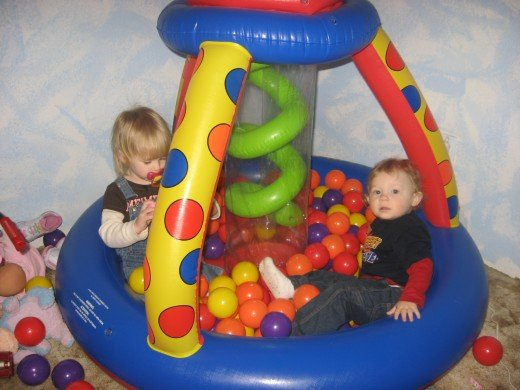My daughter and her friend in her Indoor Inflatable Ball Pit