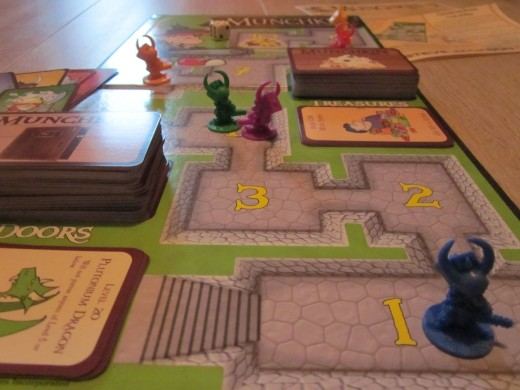 Munchkin Deluxe game board and game pieces