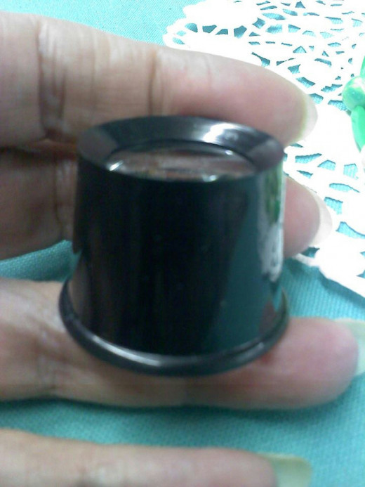 Jewelry loupe used in photo examples