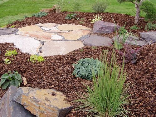 Flagstone and woodchips.