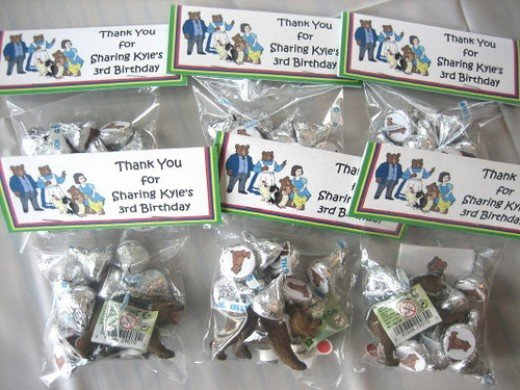 Party favors for my son's Little Bear party using personalized toppers.