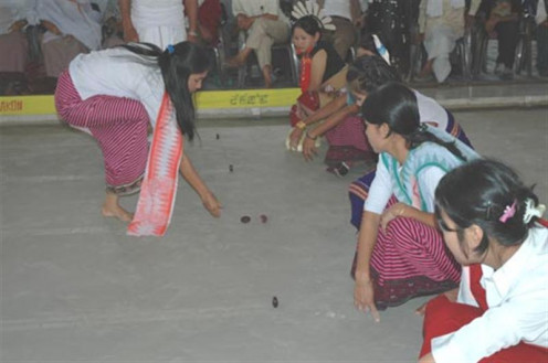 Local young women playing a game in Manipur, India.