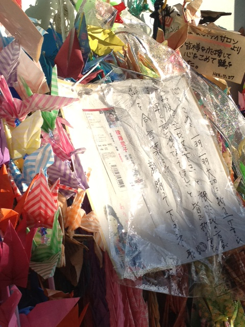 Origami cranes and letters to the victims and their families.