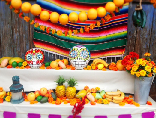 Tropical fruits, flowers and skeleton decorations.