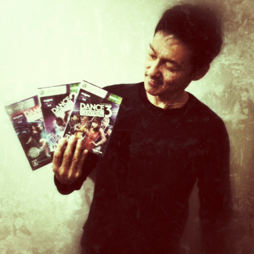 Me showing off my collection of Dance Central games.