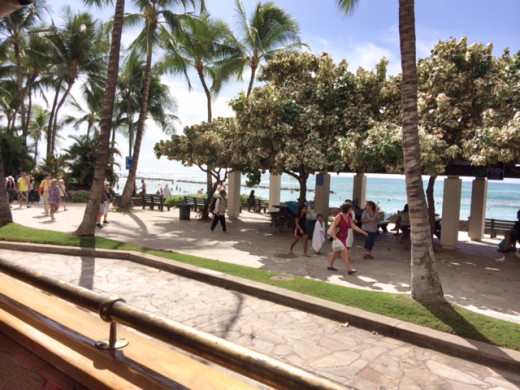 The pedestrian promenade that runs parallel to the beach.