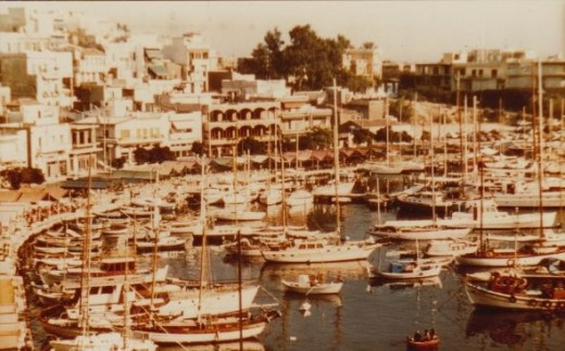 Boats and yaughts anchored in Greece harbour