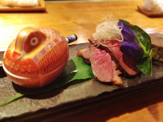 Our main course of duck with another intricate side dish inside the porcelain duck.