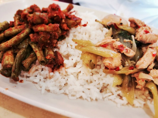 A plate of rice with spicy green beans stirp-fry and an even spicier chicken dish. My friend started tearing up after his first bite!