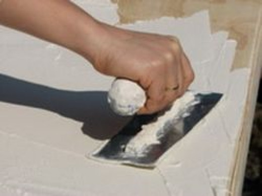 laying plaster on wood support