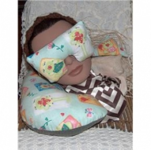 Eye mask pillow and neck pillow set that was sewn by hand.