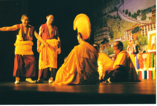 Monks debate on stage