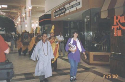 Dr. Dao Le and Risha leading the monks out of the Treasure Coast Mall