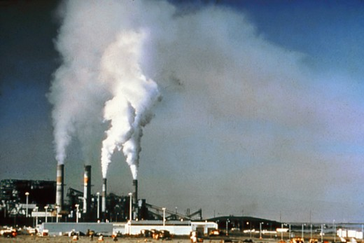 Smoke and harmful gasses released from industrial installation pollute the external air.