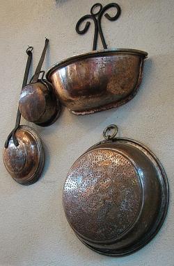 Old copper utensils displayed in a Jerusalem restaurant.