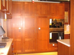 IKEA kitchen cabinets with full-height wood doors