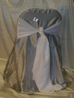 Folding chair with cover and sash.