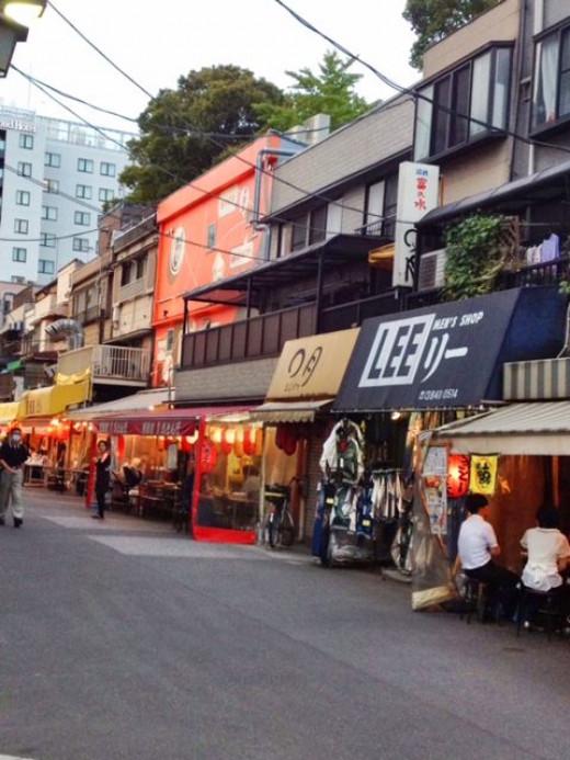 Drinking establishments line this random street.