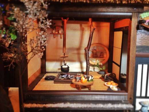 A traditional Japanese liviing room with old-style stove