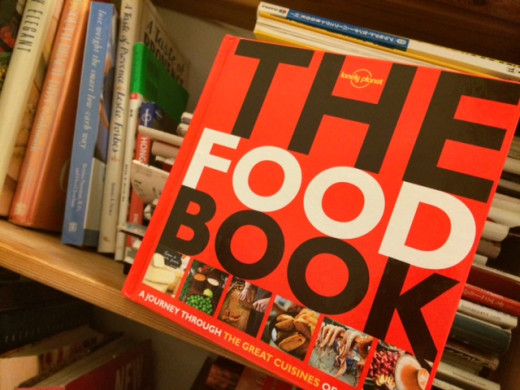 The Food Book on my bookshelf, bright red sticking out like a sore thumb.