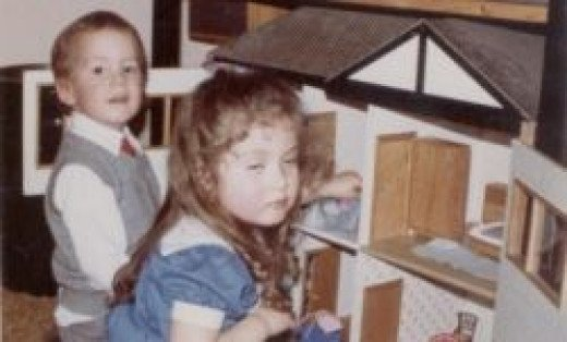 Playing with the dollhouse at a birthday party