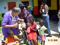 My Mom at one of the Christmas parties of 2006, for disadvantaged children in the townships.