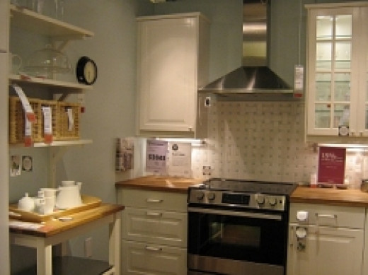 White kitchen cabinets with stainless steel range and hood - kevinw1