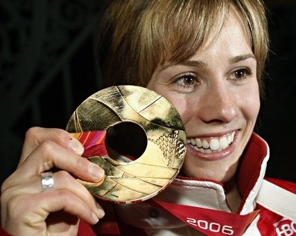 Jennifer Heil (born April 11, 1983) is a Canadian freestyle skier from Spruce Grove, Alberta. Heil was born in Edmonton, Alberta and started skiing at age 2. Jennifer Heil won the first gold medal for Canada in the 2006 Winter Olympics games in Turin