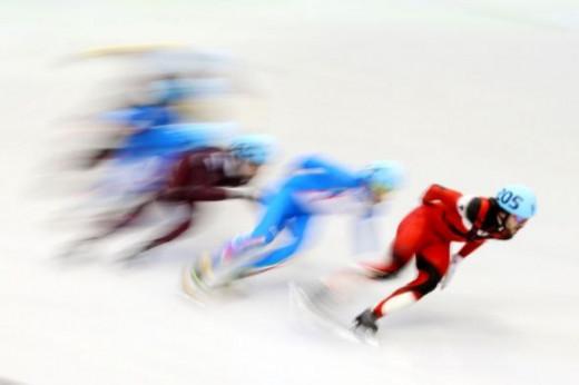 Charles Hamelin of Canada in Men's speedskating 5000 relay